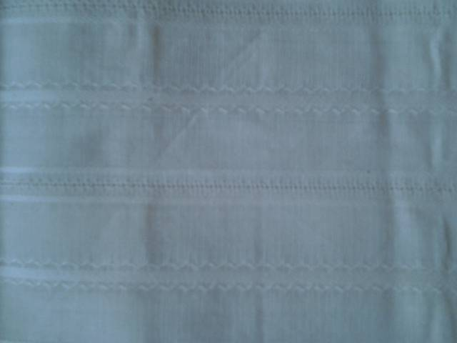 Suppliers of wholesale 40x2/60x40 grey leno dobby woven fabric manufactured in our factories in erode in salem in tirupur in tamil nadu in India.