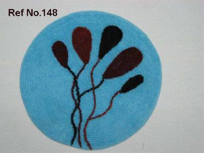 Round shaped floor bath mats manufactured using cotton terry fabric in wholesale from our factories in erode in India.